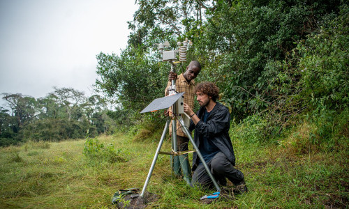 In Cameroon's Dja Faunal Reserve, guide Mempong Gaston, left, and engineer Jacob Lewallen use a FieldKit weather station to gather data on the forest.